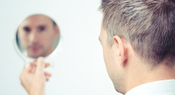 12 - Scholarly Pursuits Man and Mirror shutterstock