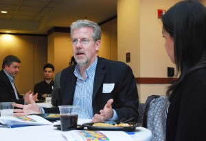 Terrence Mullen (MBA '85) (left) answers a student's career questions.