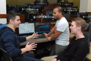 DePaul finance students talk over a problem in the school's finance lab