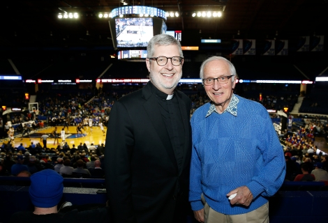 Alumnus Tom Blasczyk joins the Rev. Dennis H. Holtschneider, C.M., president of DePaul, in rooting for the Blue Demons.